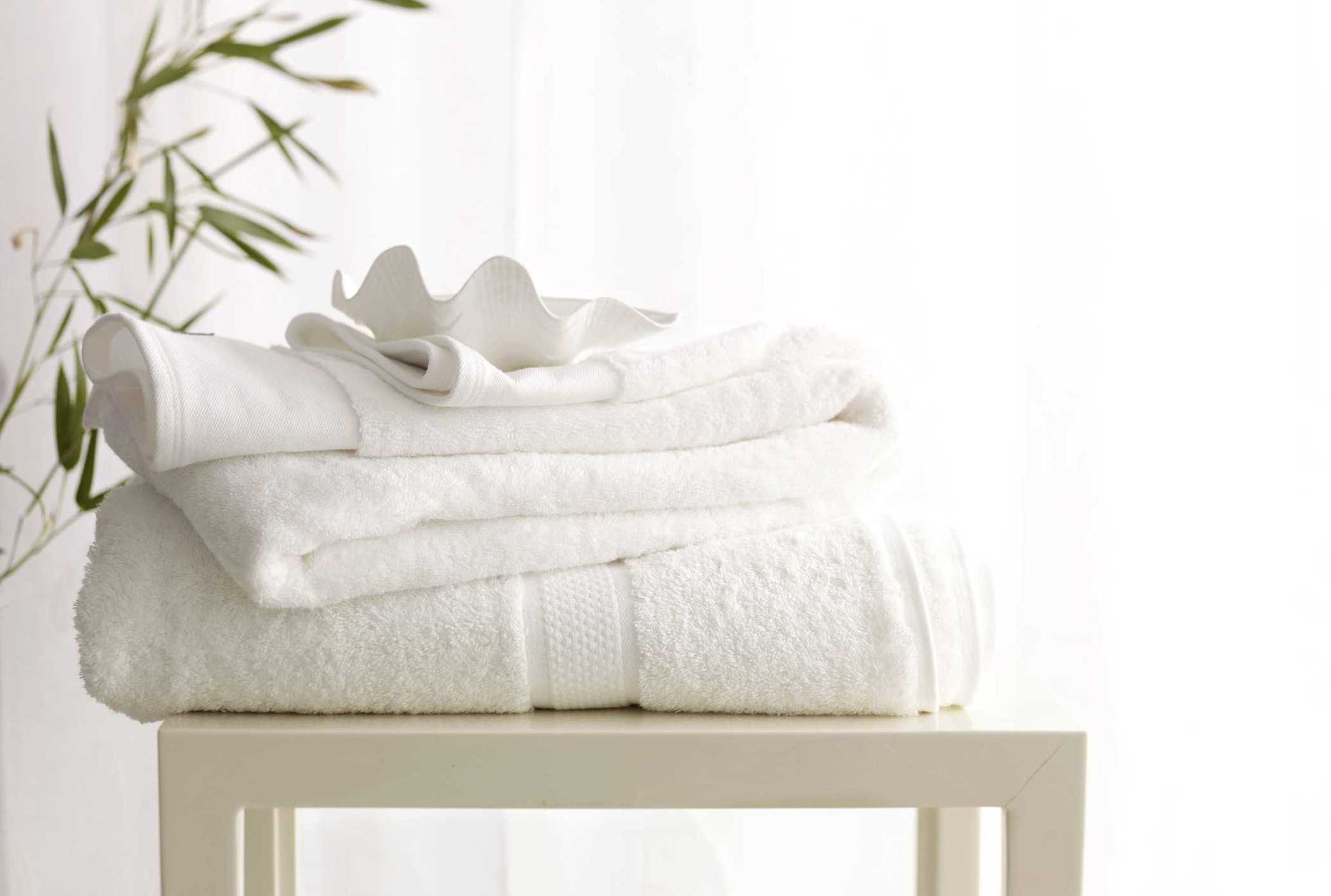Crisp white towels and linen folded neatly