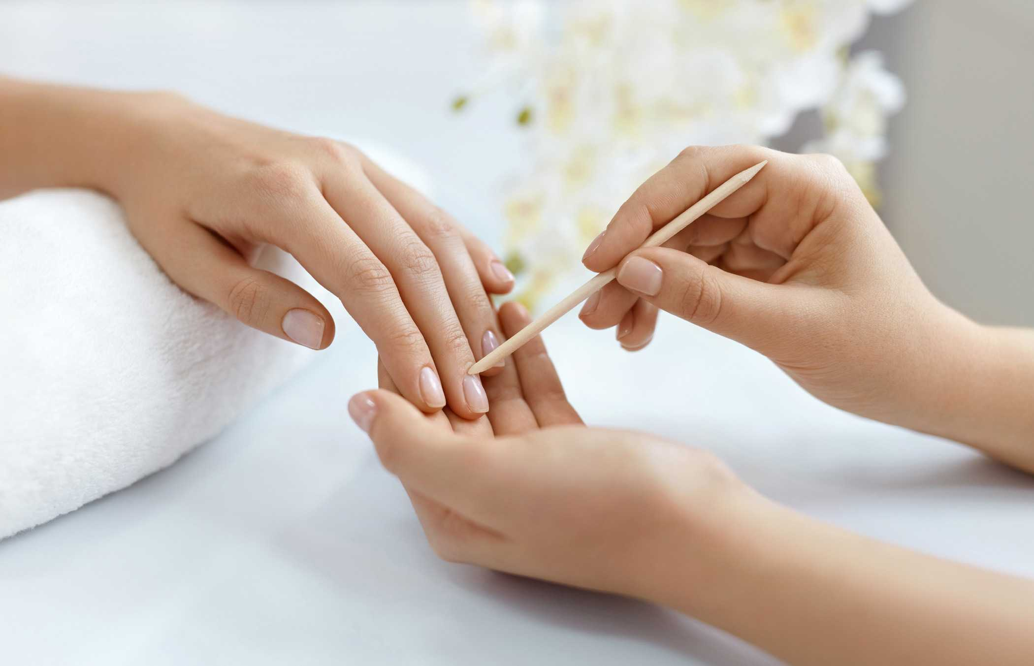 A woman receiving a manicure
