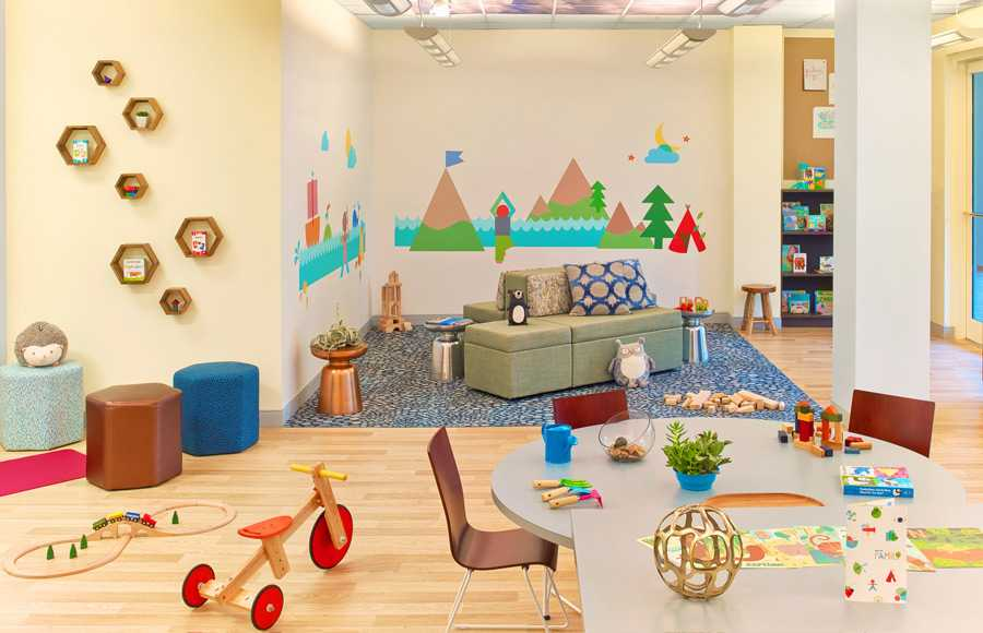 A fun children's activity room full of bright colors, toys and pictures