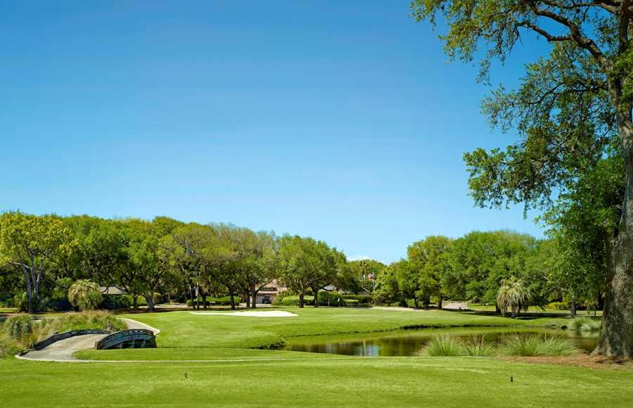 A bright open golf course with crisp green grass